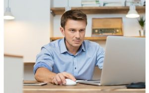 man-in-home-office-looking-at-laptop-800x500